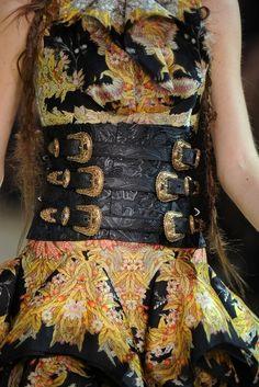 Alexander McQueen. Head-over-heels for both the dress and the belt.