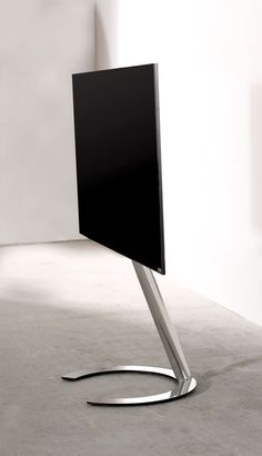 Ecoline: Design at low price level! More is less: Minimalist TV-stand. The cable management is concealed within the vertical column. Height of center of TV screen approx. 100 cm (from floor) TV to be swivelled