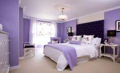 purple bedroom design with chandelier