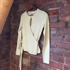 Banana Republic Wrap Sweater. Banana Republic in a pale Paris green. It's like a light honeydew melon color. Made of silk and cashmere. Pretty pearl and faux diamond button accent on front. New with tags but has a very small spot on top of right shoulder shown in picture 3 . Banana Republic Sweaters Cardigans