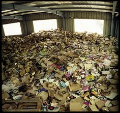 What you're looking at isn't a hoarder's home, but a neglected record warehouse photographed by Frédéric Thiphagne back in 2009.  Thiphagne was sworn to secrecy as to the warehouse's location in order to take these jaw-dropping shots. Unfortunately, the warehouse and its contents were destroyed two weeks after the photos were taken.