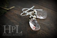 sterling silver wire wrapped Lepidocrocite Faceted Pyramid Shape Briolettefreshwater pearl and pyrite accent. $45.00