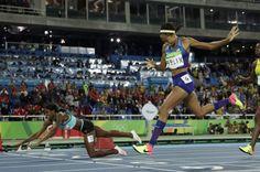 Shaunae Miller dives to gold over Allyson Felix in women's 400 meters -   .