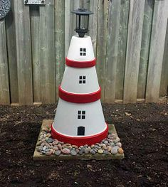Solar Clay Pot Lighthouse that my husband made...