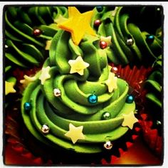 Christmas tree cupcakes made by me. Getting in the Christmas Cooking Spirit even if it is only October :) by joanne