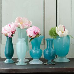 Vibrant Accents  The easiest way to give your same-old interiors a lift is to add little pops of your favorite colors here and there around your home. Clustering similarly hued items like this Frosted Blue Vase Collection ($44, shopterrain.com) can add some sophistication to your decor.