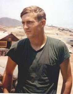 A soldier wearing a private purchase OD T-shirt featuring a pocket, perhaps to keep his cigarettes in.