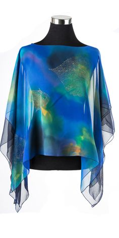 """This versatile piece can be worn as a top or as a shawl. Hand-painted on 100% silk chiffon, gives a luxuriously lightweight, silky feel to this top. Great for travel! All tops are approximately 23"""" long from top to bottom and 52"""" between the sleeves."""