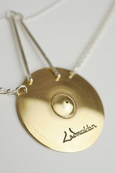 Cymbals Necklace by Lad Musician