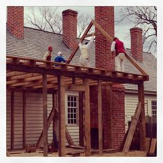 Putting Up the Frame on the Tinsmith Shop at the Armoury Site.