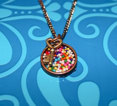 Candy sprinkle and Key metal resin pendant by GreyGyrl on Etsy, $18.00