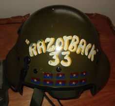 """A rare example of a Vietnam helicopter helmet painted with a count, mostly like """"KBAs,"""" or enemies confirmed """"killed by air,"""" designated with the Viet Cong flag. (Courtesy of Steve """"Tooth"""" Bookout, via VHPAMuseum.org)"""
