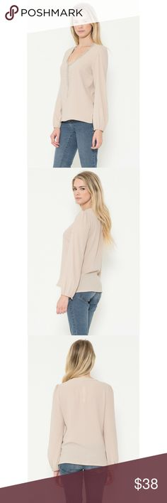 Beaded Neckline Blouse Elegant and feminine long sleeve woven blouse with beading detail on the neckline. Button closure at sleeves. Color - Blush Esley Tops Blouses