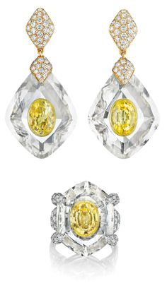 A Rock Crystal, Yellow Sapphire and Diamond Suite by Cartier. Comprising a pair of ear pendants, suspending a rock crystal set to the center with an oval-cut yellow sapphire, from a pavé-set diamond link, to a pear-shaped pavé-set diamond surmount; a similarly designed ring en suite, mounted in 18K yellow gold and platinum, ear pendants length 1 3/4 inches, ring size 7.Signed 'Cartier Paris', no.225396, 226311, with French assay marks. Via Phillips.