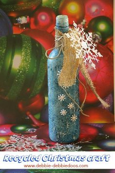 Recycled wine bottle Christmas craft idea - Debbiedoo's ~ She paints it and then re-paints it with Rit Dye!!