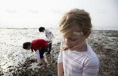 Children playing on rocky beach