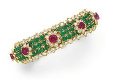 A DIAMOND, EMERALD AND RUBY BRACELET, BY DAVID WEBB  Designed as a circular-cut emerald band, set with a series of circular-cut ruby and diamond flower blossoms, to the circular-cut diamond trim, mounted in 18k gold, circa 1965