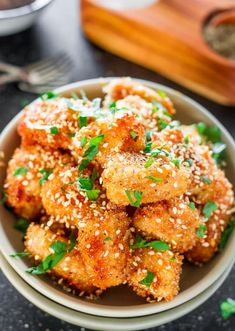 Baked Honey Garlic Chicken - little chicken nuggets, breaded and baked to a crispy perfection, then drizzled with a sweet, spicy and garlicky sauce.