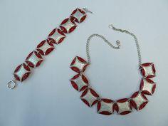 Collier aus Kaffee-Kapseln rot (Decaffeinato) und silber, ca. 48 cm Gesamtlänge. Durch die Verlängerungskette variabel in der Länge zu tragen. Armband mit Verschluss ca. 21,5 cm.