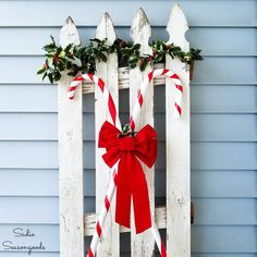 Wooden walking canes are simply PERFECT for upcycling into candy cane decorations to use on your front porch this Christmas season! And it's so easy to make with this repurposing idea from Sadie Seasongoods. Mason Jar Christmas Decorations, Christmas Vases, Elegant Christmas Decor, Classy Christmas, Christmas Porch, Xmas Decorations, White Christmas, Holiday Decor, Christmas Parties