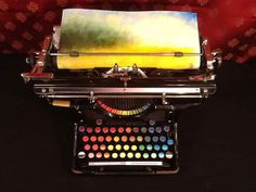 Created by Tyree Callahan: Chromatic Typewriter; entered into 2012 West Prize competition. Callahan replaced ink pads of typewriter with colored paint pads and letters with color markers. WANT.