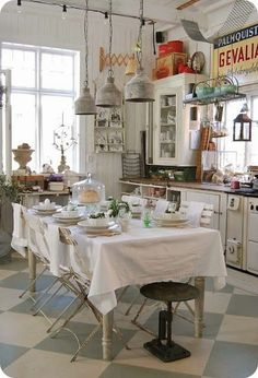 vintage kitchen Vintage cabinets and industrial lighting and signage combines country styles in this kitchen Farmhouse Kitchen Decor, Vintage Farmhouse, Farmhouse Style, Eclectic Kitchen, Kitchen Interior, Country Kitchen Designs, Kitchen Country, Farmhouse Sinks, Kitchen Modern