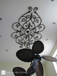 This is our Simone design. Simone is a faux iron ceiling medallion that pairs wonderfully with any existing ceiling fixture. Here Simone is complete in our Antique Bronze finish.