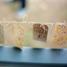 Escort cards hand-made by the bride were fashioned from postal tags and floral-patterned adhesive paper. Lisa Berry Photography.