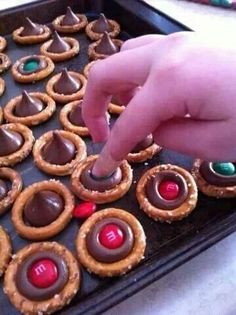 Choco pretzel numminess.. use Reeses Pieces instead of m&ms.