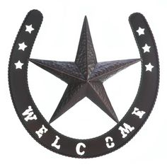 Give your friends and family a big welcome with this striking iron wall decor. A large lonestar rests inside a lucky horseshoe emblazoned with welcome in Wild West style. Western Star Wall Decor by Rustica House. #myRustica