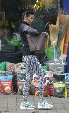 Pert-fect! Michelle's slender frame looked amazing as she walked past the shops, her leggi...