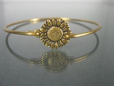 This bracelet features a highly detailed Sunflower at its center. Its the perfect accessory or gift for anyone who adores this amazing flower! It