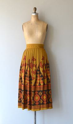 Vintage cotton and wool blend skirt with high banded waist and large scale southwestern geometric print. Lined.  See this skirt in action ➸