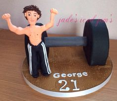 Gym cake. Gym themed cake. Weights cake. Fondant figure, sugar craft man.