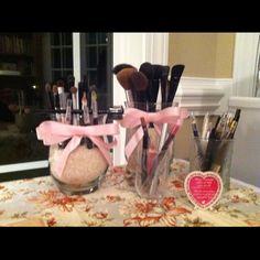 Brush holders - half price jars, pink ribbon, hot glue gun and rice.