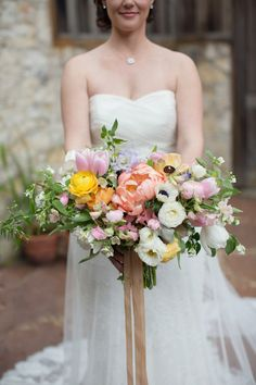 stunning watercolor bouquet featuring peonies, ranunculus, tulips, sweet pea, and poppies by Lilify