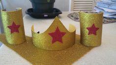 Wonder Woman Headband & Cuffs DIY. Things you will need 1. Headband 2. Toliet paper rolls (2) 3. Silly Winks glitter sheets (2)-styrofom 4. (3) glitter stars (red) 5. Tacky Glue