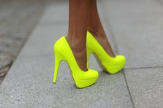 shoes neon high heels yellow with Raascals shirt and a black skirt.