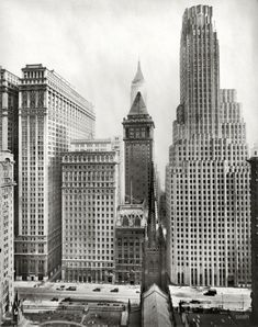 "New York circa 1931. ""Irving Trust Building, 1 Wall Street."" The Art Deco behemoth on the right, with Trinity Church and its cemetery in the foreground and Equitable Building on the left, along with American Surety, the Bankers Trust pyramid and Bank of Manhattan (rear). Irving Underhill photo."