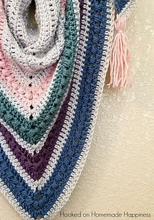 I was inspired by our gorgeous weather and pretty pastels to make this Spring Shawl Crochet Pattern. It can be worn over the shoulders like a shawl, or wrapped up like a triangle scarf. I love all the options with triangle shawls!