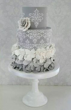 Love the lace pattern in white on pink cake, with teal highlights. Forget the ruffles on base tier - too fussy.