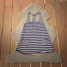 black and white striped racerback tank lightly worn. no damages. soft fabric. miuse. Francesca's Collections Tops Tank Tops