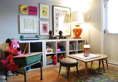 Frame kids art and put above Wall Unit in playroom.