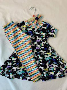 This outfit consists of a unicorns in space twirl dress with short sleeves, rainbow triangle leggings (that match the neckband) and a rainbow triangle bow. Whats not to love about unicorns in space? This twirl dress falls just at or below the knees. All seams are professionally finished. Let her