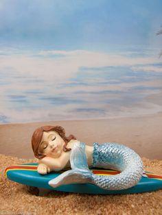 Mini Mermaid dreaming in the fairy garden.