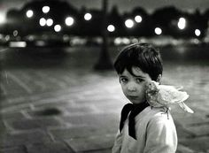 """Robert Doisneau - Portrait du fils de Pierre Derlon pour le livre """"L'enfant et la colombe"""", co-écrit avec James Sage, circa 1970."""