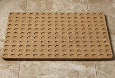 Cork Bath Mat -- This naturally antimicrobial, antifungal and hypoallergenic material from the Cork Oak tree also makes for a unique nonslip and quick-drying alternative to traditional fabric mats.