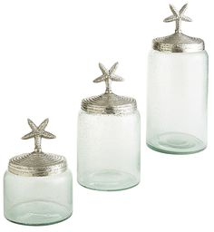 Bring beach house style home—minus all the sand—with Pier 1's canister trio. Each is handcrafted of green glass and topped with a starfish-motif aluminum lid. These canisters coordinate perfectly with our Seaside Tabletop Collection.