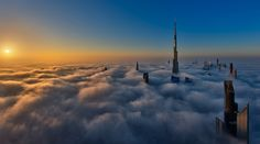 Dubai-based photographer Daniel Cheong takes wonderfully ethereal photos of Dubai's skyscrapers emerging from thick layers of fog. Cheong captures the fog--a rare weather phenomenon in Dubai--from . Dubai City, Dubai Skyscraper, Dubai Uae, Mauritius, Ligne D Horizon, Cloud City, Above The Clouds, Night City, Burj Khalifa