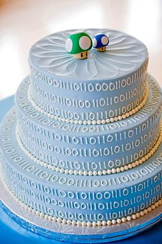I haven't thought about wedding stuff much, but I would definately get this cake for my wedding!!!  Cake Wrecks - Home - Sunday Sweets: Geek WeddingCakes!